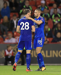 """Leicester City's Islam Slimani celebrates scoring his side's second goal of the game with team mate Leicester City's Christian Fuchs during the Carabao Cup, Second Round match at Bramall Lane, Sheffield. PRESS ASSOCIATION Photo. Picture date: Tuesday August 22, 2017. See PA story SOCCER Sheff Utd. Photo credit should read: Tim Goode/PA Wire. RESTRICTIONS: EDITORIAL USE ONLY No use with unauthorised audio, video, data, fixture lists, club/league logos or """"live"""" services. Online in-match use limited to 75 images, no video emulation. No use in betting, games or single club/league/player publications."""