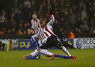 Sheffield United forward Leon Clarke (9) is fouled by Sheffield Wednesday defender Michael Hector  (34)  during the EFL Sky Bet Championship match between Sheffield United and Sheffield Wednesday at Bramall Lane, Sheffield, England on 9 November 2018.