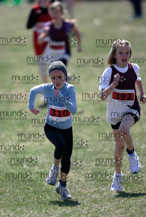 (Kingston, Canada---11 April 2010) \310/ /392\ runs in the Elementary Girls race at the 17th World University Cross Country Championships (FISU) held on the Fort Henry Hill course in Kingston, Ontario, Canada. .Geoff Robins/ Mundo Sport Images..This photograph is Copyright Geoff Robins / Mundo Sport Images, 2010. For information, go to www.mundosportimages.com or contact info@mundosportimages.com.