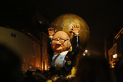 © Licensed to London News Pictures. 05/11/2015. Lewes, UK. A Sepp Blatter effigy is carried during a bonfire parade in Lewes, Sussex during the traditional Bonfire Night celebrations on Thursday, 5 November, 2015. Thousands of people attend the parade through the narrow streets of Lewes and burn effigies to celebrate Guy Fawke night. Photo credit: Tolga Akmen/LNP