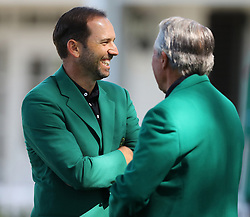 April 1, 2018 - Augusta, GA, USA - Defending Masters champion Sergio Garcia shares a laugh with three-time champion Gary Player outside the clubhouse on Sunday, April 1, 2018 at Augusta National Golf Club in Augusta, Ga. (Credit Image: © Curtis Compton/TNS via ZUMA Wire)