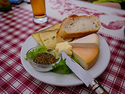 Close-up of French cheese and baguette meal on table, Vosges, France