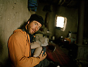 Matthieu Paley at an opium dealer's house..Winter expedition through the Wakhan Corridor and into the Afghan Pamir mountains, to document the life of the Afghan Kyrgyz tribe. January/February 2008. Afghanistan