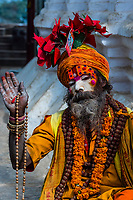 A Sadhu (holy man) at the Swayambhunath Stupa. The temple sits atop a hill west of Kathmandu, Nepal.
