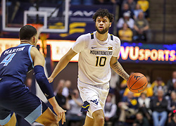 Dec 1, 2019; Morgantown, WV, USA; West Virginia Mountaineers guard Jermaine Haley (10) dribbles during the second half against the Rhode Island Rams at WVU Coliseum. Mandatory Credit: Ben Queen-USA TODAY Sports