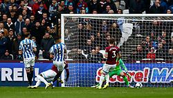 Juninho Bacuna of Huddersfield Town scores and celebrates - Mandatory by-line: Phil Chaplin/JMP - 16/03/2019 - FOOTBALL - London Stadium - London, England - West Ham United v Huddersfield Town - Premier League