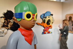 "© Licensed to London News Pictures. 06/10/2017. London, UK.  A character called ""The Juniors: Kirby"", 2017, by Hebru Brantley at the Moniker Art Fair, the world's biggest urban art fair, taking place at the Old Truman Brewery in East London from 5 to 8 October 2017.  The fair brings together the world's most influential new-contemporary and urban art galleries to show international artworks to Londoners. Photo credit : Stephen Chung/LNP"