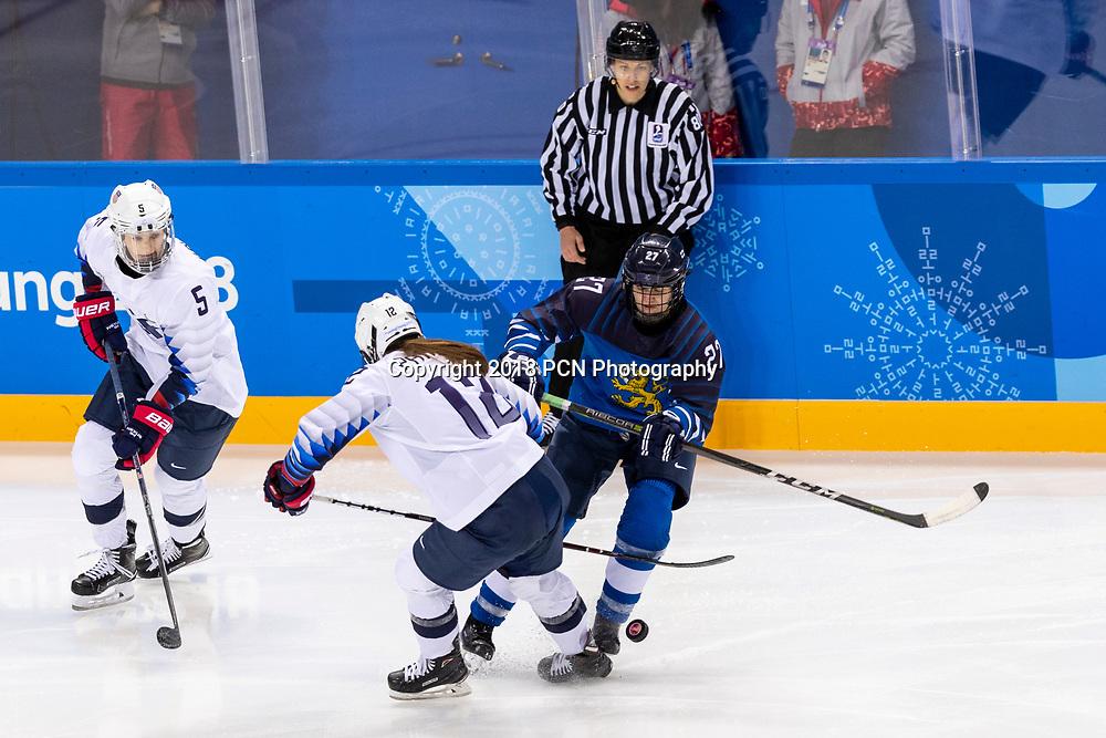 Megan Keller (USA) #5 and Saila Saari (FIN) #27 during USA-FInland Women's Hockey competition at the Olympic Winter Games PyeongChang 2018
