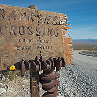 A road sign marks a junction on rough back roads in Death Valley National Park, California.