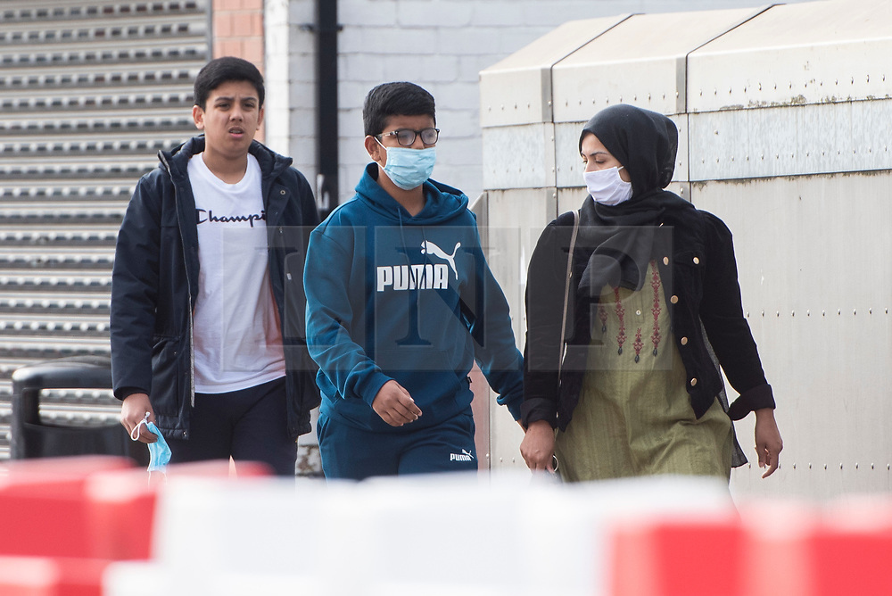 © Licensed to London News Pictures. 04/09/2020. Bolton, UK. Members of the public wear face masks on a quiet morning in local lockdown in Bolton. Bolton now has the highest infection rate in the UK. Photo credit: Kerry Elsworth/LNP