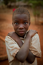 Fodensia Ezeliel, 8, poses as she gets ready to go to school. She is the daughter of Ezekiel Kaboya, 40 who was a fisherman but had to stop because he was not able to make a living. Instead, he now cuts trees and sells the wood in the village of Nkonkwa, on Lake Tanganyika in Tanzania.