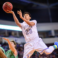 031115  Adron Gardner/Independent<br /> <br /> Laguna Acoma Hawk Kameron Joe (23) elevates for a field goal attempt on the Texico Wolverines during a 3A New Mexico state basketball tournament quarterfinal at the Santa Ana Star Center in Rio Rancho Wednesday.