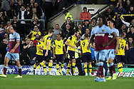 Oxford United players celebrate a goal by Matty Taylor (9) of Oxford United (2-0) during the EFL Cup match between Oxford United and West Ham United at the Kassam Stadium, Oxford, England on 25 September 2019.