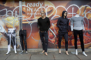 Old mannequins stand in front of graffiti and a Tesco hoarding at Elephant and Castle shopping centre, on 29th March, 2018 in London, England.