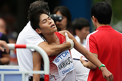 Japan's Yuki Kawauchi collapses after finishing 18th in the Men's Marathon