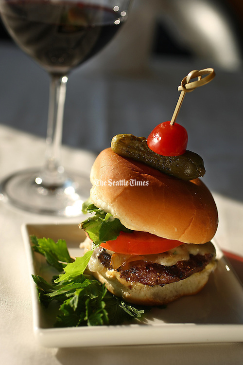 Petite burger with a glass of Distant Bay Cabernet Sauvignon from Washington. <br /> John Lok / The Seattle Times