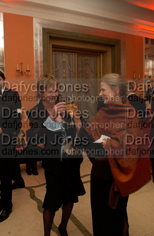 Emily Mortimer's mother, Penny Mortimer and Alessandro Nivola's mother toast being grandmothers, Bright Young Things Royal European charity premiere in Leicester Sq. and party afterwards at  Claridges, 28 September 2003. © Copyright Photograph by Dafydd Jones 66 Stockwell Park Rd. London SW9 0DA Tel 020 7733 0108 www.dafjones.com