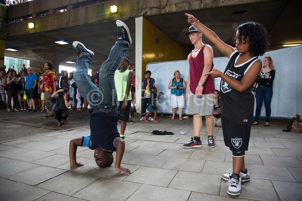 Young people gather for an urban street culture weekend on the Southbank. Here underneath Hungerford Bridge, youths join in various dance-off and breakdancing displays. The South Bank is a significant arts and entertainment district, and home to an endless list of activities for visitors and tourists alike.