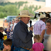 Cal Ruark discuss the preshow plans at the Darby MT Kiddie Rodeo July 7th 2017.  Photo by Josh Homer/Burning Ember Photography.  Photo credit must be given on all uses.