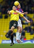 Photo: Scott Heavey.<br />Watford v Crystal Palace. Nationwide Division One. 17/01/2004.<br />Aki Riihilahti beats Gavin Mahon in the air