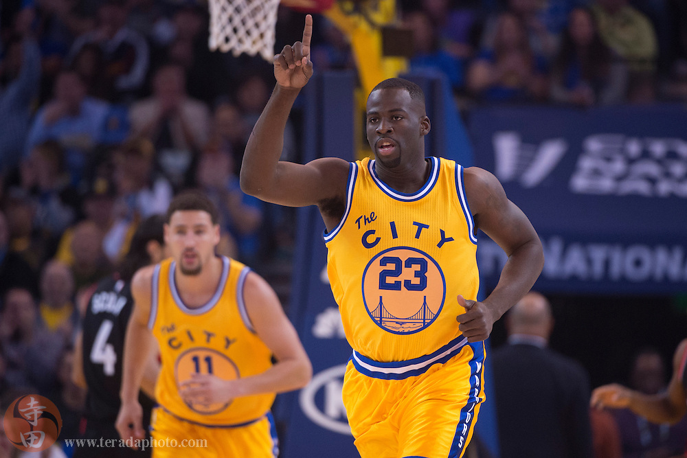 November 17, 2015; Oakland, CA, USA; Golden State Warriors forward Draymond Green (23) celebrates in front of guard Klay Thompson (11) during the first quarter against the Toronto Raptors at Oracle Arena. The Warriors defeated the Raptors 115-110.