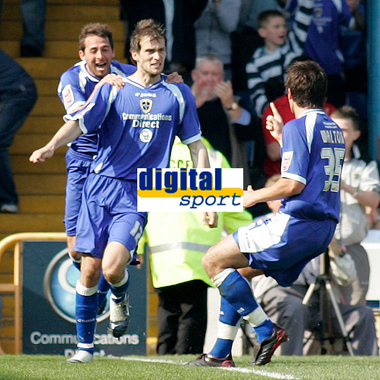 Photo: Mike Greenslade..Cardiff City v Sheffield Wednesday..Coca Cola Championship League..07.04.07..Ninian Park..KO 3pm...Michael Chopra and Simon Walton joins in the goal celebrations with scorer Roger Johnson (cnter)