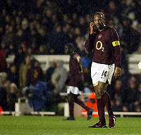 Photo: Chris Ratcliffe.<br />Arsenal v Ajax. UEFA Champions League. 07/12/2005.<br />Thierry He nry ponders his penalty miss in the rain at Highbury