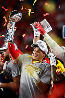 Kansas City Chiefs quarterback Patrick Mahomes holds up the Lombardi trophy following action against the San Francisco 49ers during the NFL Super Bowl 54 football game Sunday, Feb. 2, 2020, in Miami Gardens, Fla. <br /> <br /> ( Tom DiPace via AP)