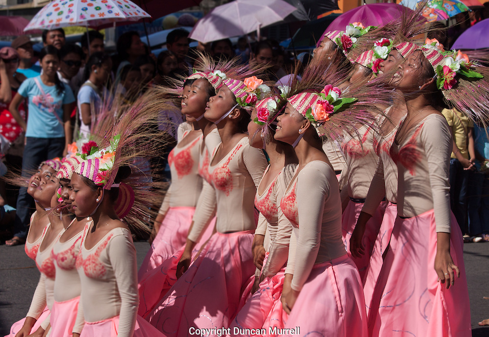 Dancers performing in the Balayong Festival street dancing competition. The festival at the beginning of March commemorates the founding anniversary of the City of Puerto Princesa, Palawan, highlighted by balayong tree-planting, street dancing and a colourful floral parade depicting the Palawan cherry blossoms from which the festival derives its name. The Palawan cherry is one of the most popular flowering trees in Palawan and known by the locals as the Balayong, a beautiful tree that when it is in full bloom resembles the cherry blossoms of Japan.