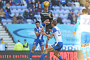 Scott Wiseman heads at goal during the EFL Sky Bet League 1 match between Wigan Athletic and Rochdale at the DW Stadium, Wigan, England on 24 February 2018. Picture by Daniel Youngs.