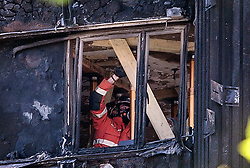 © Licensed to London News Pictures. 19/06/2017. London, UK. Re-enforcement work being carried out to levels of the Grenfell Tower Block which was severely damaged in a fire last week.  The blaze engulfed the 27-storey building killing dozens - with dozens of people still in hospital, many of whom are in critical condition. Photo credit: Ben Cawthra/LNP