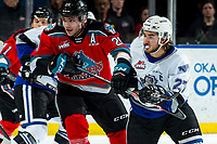 KELOWNA, BC - MARCH 11: Matthew Wedman #20 of the Kelowna Rockets stick checks Phillip Schultz #27 of the Victoria Royals at Prospera Place on March 11, 2020 in Kelowna, Canada. (Photo by Marissa Baecker/Shoot the Breeze)