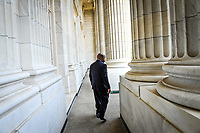 Washington, DC, U.S.A  -- Rep. John Lewis, D-Ga., walks along the outside balcony of his office in the Cannon Building in Washington, DC. Lewis, a former Freedom Rider and the last surviving major organizer of the March on Washington, recalls the days when he and his contemporaries would dress in suits and ties for demonstrations, determine themselves to practice non-violence and come prepared for jail (with paper bag that included toothbrush and a piece of fruit).   --   Photo by Jack Gruber, USA TODAY