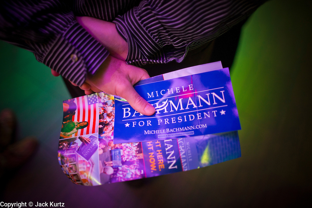 """11 DECEMBER 2011 - SCOTTSDALE, AZ:    A Michele Bachmann supporter waits for the Congresswoman and Republican presidential hopeful to arrive at a fundraiser sponsored by Politics on the Rocks at the Mint in Scottsdale, AZ, Sunday. The Mint is a popular bar and restaurant built in a former bank in Scottsdale, AZ. Politics on the Rocks was started by Charles A. Jensen in Scottsdale, Arizona. The purpose of """"Politics on the Rocks"""" is to bring Republican & Conservative Professionals together in a monthly happy hour where they can network, socialize, and hear directly from prominent politicians and successful business leaders.      PHOTO BY JACK KURTZ"""