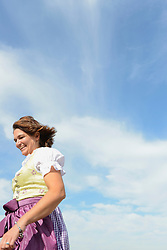 Mature woman running and smiling, Bavaria, Germany