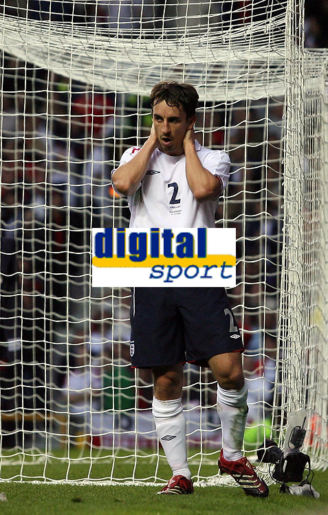 Photo: Paul Thomas.<br /> England v Macedonia. UEFA European Championships 2008 Qualifying. 07/10/2006.<br /> <br /> Gary Neville of England can't bvelieve he missed a good chance for goal.