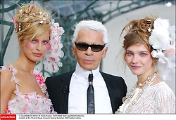 © Java/ABACA. 41622-15. Paris-France, 21/01/2003. Karl Lagerfeld flanked by models at the Chanel Haute Couture Spring-Summer 2003 fashion show.