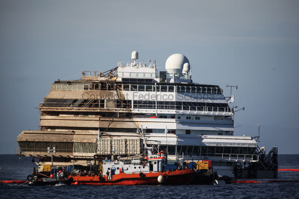 The Costa Concordia ship wreck prow, with the right side dirty after been submerged one an half year