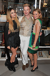 Left to right, ZARA MARTIN, HENRY CONWAY and AMBER ATHERTON at a party to celebrate the opening of the new Nicole Farhi global flagship store at 25 Conduit Street, London W1 on 19th September 2011.