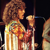 """Roger Daltrey - The Who .-.Daltrey in his customary tassels was on top form. He worked his way through a marathon set that saw the sun come up on Sunday morning. The set included favourites like """"Tommy"""", """"Shaking all Over"""" and """"My Generation"""". The crowd loved it."""