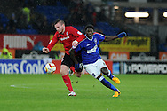 Cardiff city's Aron Gunnarsson (l) holds off Guirane N'Daw of Ipswich (r).  NPower championship, Cardiff city v Ipswich Town at the Cardiff city Stadium in Cardiff, South Wales on Saturday 12th Jan 2013. pic by Andrew Orchard, Andrew Orchard sports photography,