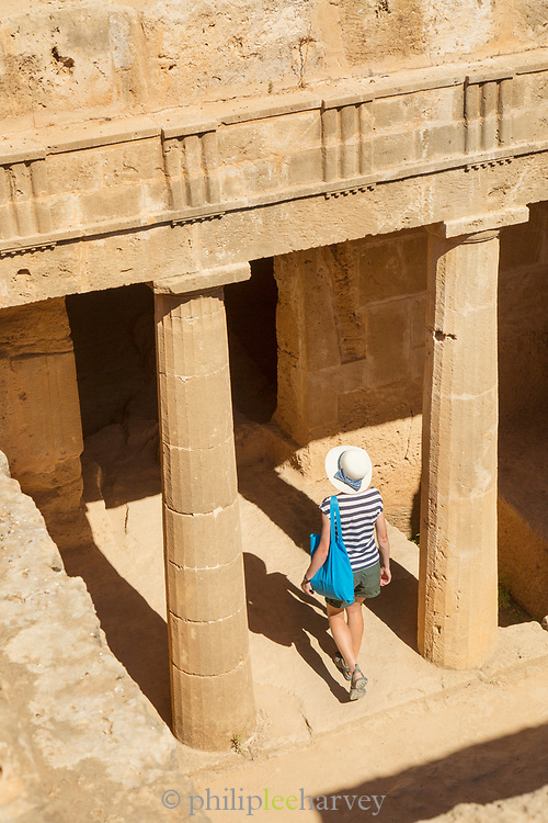 Female tourist walking into ruins captured from high angle, Paphos Archaeological Park, Paphos, Cyprus
