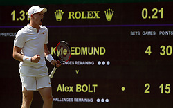 Kyle Edmund celebrates a point during his match on day two of the Wimbledon Championships at the All England Lawn Tennis and Croquet Club, Wimbledon.
