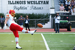 19 September 2015:  Braden Meints punts during an NCAA division 3 football game between the Simpson College Storm and the Illinois Wesleyan Titans in Tucci Stadium on Wilder Field, Bloomington IL