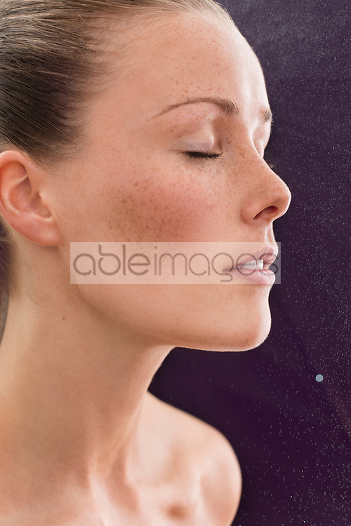Beauty Water Spraying on Woman Face