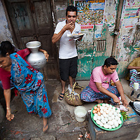 A street scene around in old Dhaka, Bangladesh. A street vendor sells eggs for breakfast