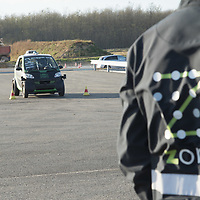 Worker watches as self-driving car testing already goes on as road constructions are still in progress during a press visit at the Zone test track aimed to support development of autonomous self-driving vehicles in Zalaegerszeg (about 220 kilometres South-West of capital city Budapest), Hungary on Nov. 12, 2018. ATTILA VOLGYI