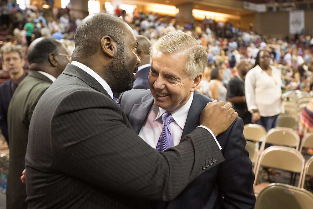U.S. Senator Lindsey Graham (R-SC), right, attends a vigil for the nine people shot and killed inside Emanuel African Methodist Episcopal Church was held at TD Arena in Charleston, South Carolina on June 19, 2015. The victims were killed on June 17, 2015. A suspect, Dylann Roof, 21, was arrested in connection with the shootings. Photo by Kevin Liles/UPI