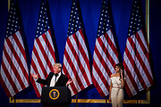 U.S. President Donald Trump adresses the audience as First Lady Melania Trump looks on at the Armed Services Inaugural Ball in Washington, D.C., on Friday, Jan. 20, 2017. Senate Democrats and Republicans are tussling over how many of Trump's nominees can be confirmed on his first day in office, with Republicans threatening to work through the weekend to break the logjam.
