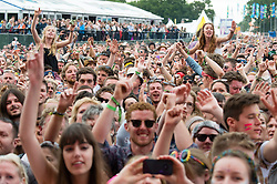 © Licensed to London News Pictures. 14/06/2015. Isle of Wight, UK.  Festival goers watch Paolo Nutini perform at Isle of Wight Festival 2015 on Sunday Day 4.  Yesterday suffered torrential rain all afternoon and evening, after a first day of warm sun.  This years festival include headline artists the Prodigy, Blur and Fleetwood Mac.  Photo credit : Richard Isaac/LNP